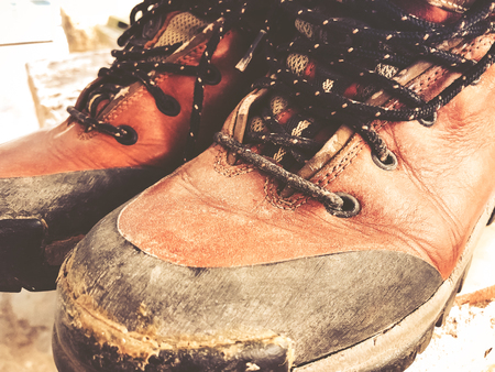 Old red dirty high shoes . Old school vintage worn boots. Archivio Fotografico