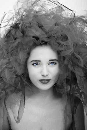 Beautiful young model. Gorgeous Woman Face in black and white effect.