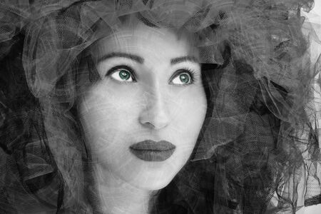 Portrait of beautiful young woman. Fashion photo in black and white effect. Banco de Imagens