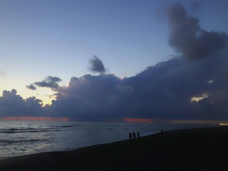Evening sea view, clouds in the sky, sea, beach.
