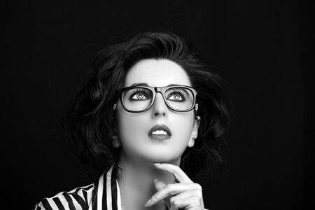 Image of a beautiful young woman wearing glasses. Banco de Imagens