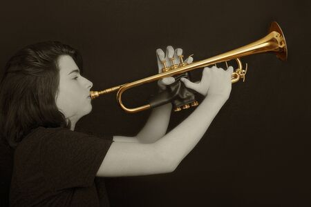 Portrait of a teenager with trumpet in studio