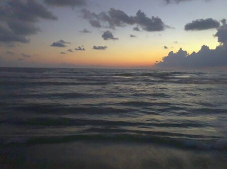 Evening sea view, clouds in the sky, sea, beach.