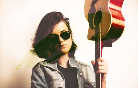 Portrait of a teenager with guitar in studio Stock Photo