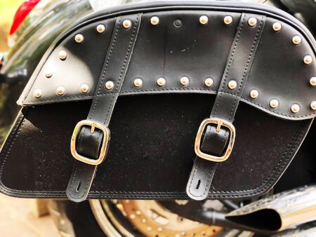 Leather biker bag on a motorcycle close-up. Concept travel on a motorcycle. 版權商用圖片