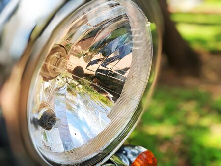 Chromed headlamp of a motorcycle, stylish classic chrome-plated motorcycle headlight