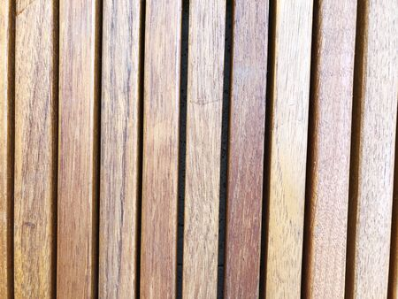The brown wood texture with natural patterns.