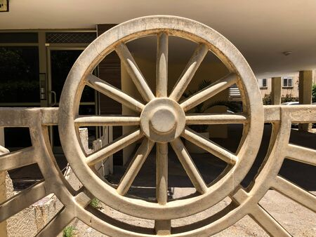 Architecture in the form of an old wheel from a cart.