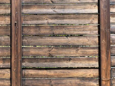 A beautiful wooden fence with cracked paint. Close-up. 写真素材