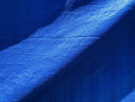 Blue background texture. Background of blue fabric and sky. 写真素材 - 134398044