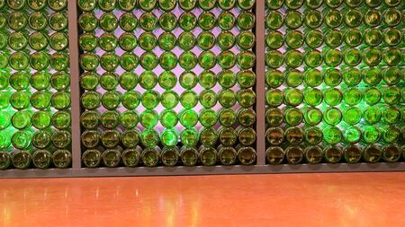 Glass green bottoms from bottles. Abstract background with copy space
