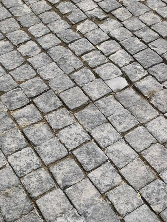 Stone tiles paved road. Close shot.