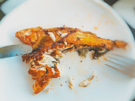 Fried fish on a porcelain dish.