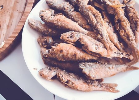 A lot of fried fish on a porcelain dish. 写真素材