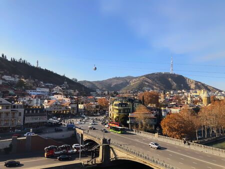 TBILISI, GEORGIA - December 17 2019: Beautiful landscape of the old district, view of the bridge. Old Tbilisi, winter in the city. 写真素材