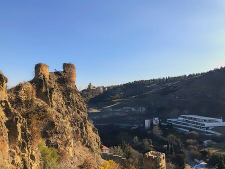 Beautiful view of the old fortress overlooking the botanical garden. Old Tbilisi, winter in the city.