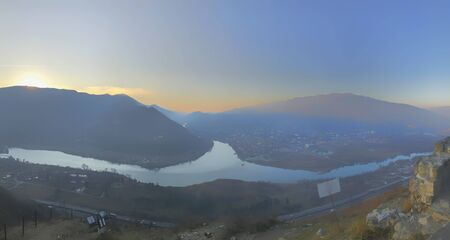 Beautiful panoramic view from the old fortress overlooking the stretching mountains and the river.