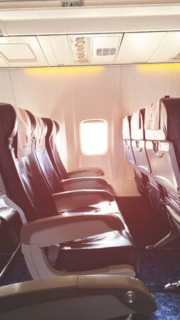 TBILISI, GEORGIA - FEBRUARY 5, 2020: Airplane seats inside. Empty seats without passengers near the window Foto de archivo