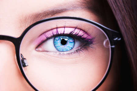 Beautiful young woman wearing glasses close-up  Imagens
