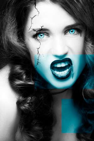 Pretty female fashion model posing in studio with dark gothic make up