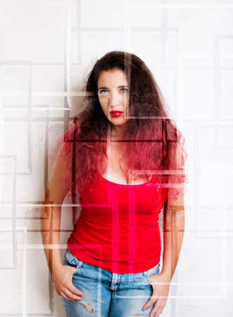 Beautiful young woman in blue jeans and a red shirt