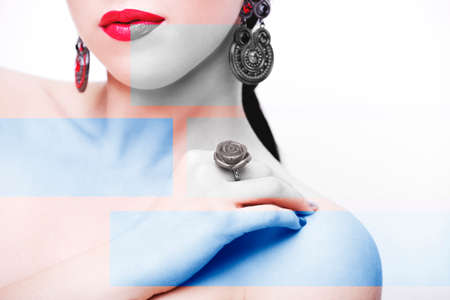 Beautiful woman face with red lips. Jewelry and Beauty Imagens