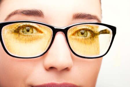 Beautiful young woman wearing glasses close-up