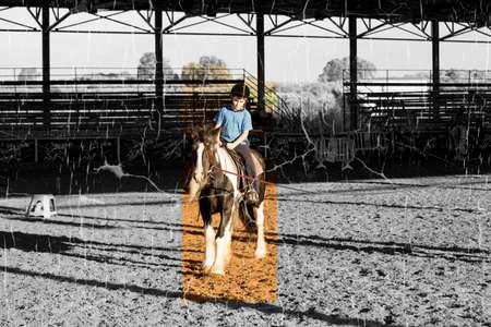 Ber Yakov, Israel - September 28, 2016: Horse riding lessons for kids. The boy on the horse Standard-Bild