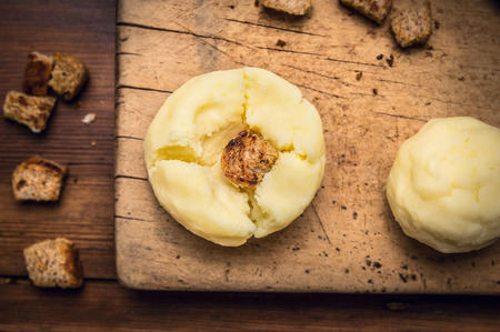 crouton: Potato dumplings with crouton making on wooden background, germany national food