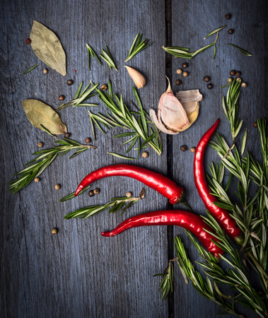 Red chili , rosemary and spices on old blue wooden background, top view Stock Photo