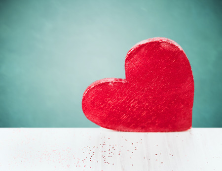 Big red heart on white wooden table over  blue background,valentine photo