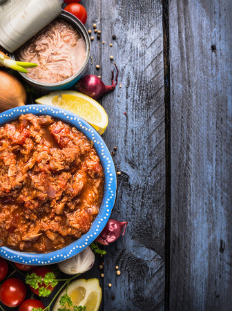 Tuna tomato sauce , ingredients on blue wooden background, top view,  place for text photo