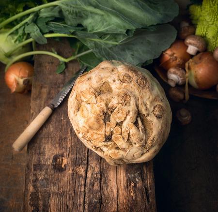 apium graveolens: Celeriac celery on old wooden table over vegetables background Stock Photo