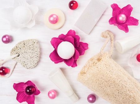 bast: bath set with pink oil balls on white wooden table, top view Stock Photo