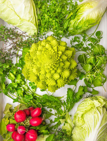 green leafy vegetables: Composition of Varieties of cabbage,green herbs mix and radishes, top view