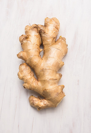 raw Ginger root on white wooden background, top view