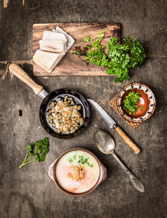 hot soup: Potato soup with cracklings on old wooden table, top view Stock Photo