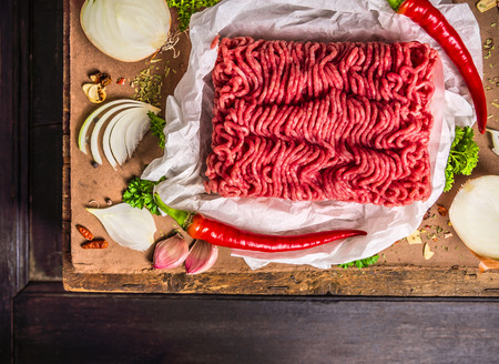 Raw ground beef with spices and herbs, top view