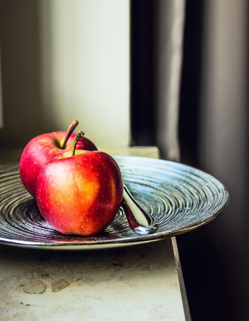 silver tray: Red apples on a silver tray on a windowsill Stock Photo