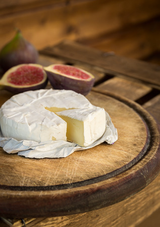 camembert: Slice camembert on old wooden board