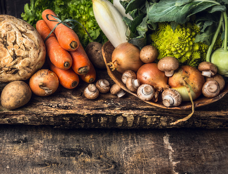 raw vegetables and edible root various on dark wooden rustic background Archivio Fotografico