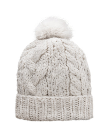 pompon: white knitted cap with pompon, isolated on white