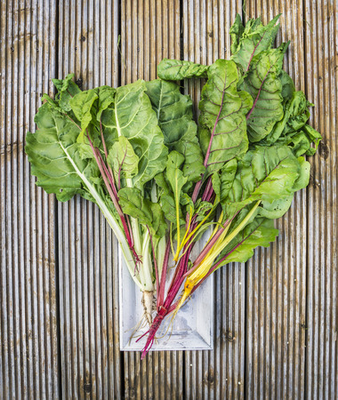 l nutrient: multicolored chard on old wooden background