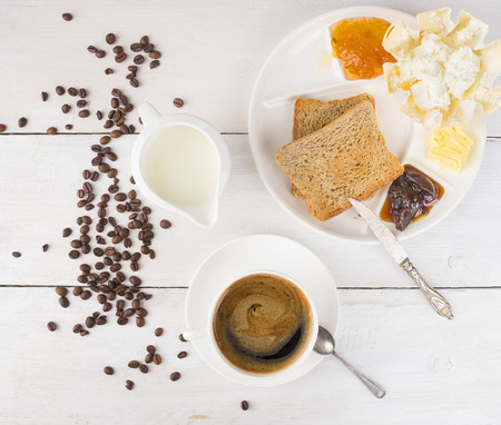 morning breakfast: Morning breakfast with coffee on white wooden table,top view