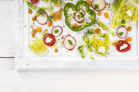 vegetable tray: Summer vegetable salad on white tray Stock Photo