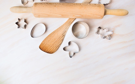 easter cookie: Bake tolls and easter cookie cutters on white wooden background, top view Stock Photo