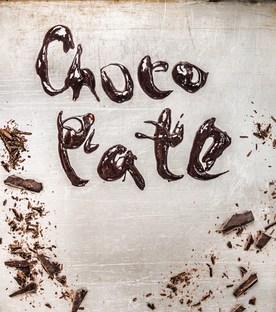 melted chocolate: inscription with melted chocolate on metallic background Stock Photo