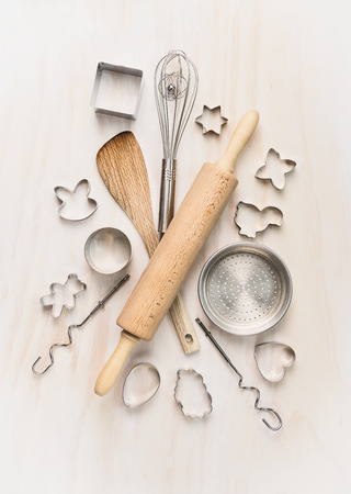 various kitchen bake utensils on white wooden table, top view photo