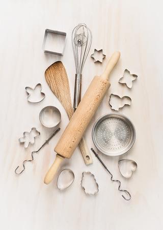 whisk: various kitchen bake utensils on white wooden table, top view Stock Photo