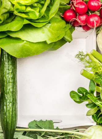veggie tray: Salad vegetables  ingredients around white wooden tray, top view,place for text Stock Photo